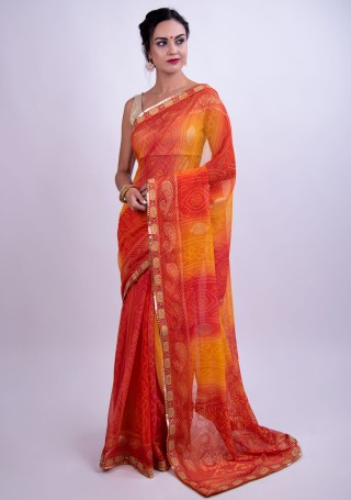 Coral and Yellow Bandhej Foil Printed Georgette Saree